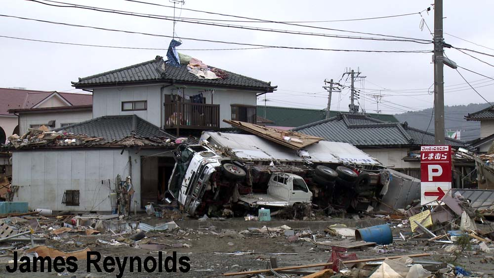 Truck hurled into the side of a house in Ishinomaki
