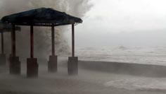 Large waves crash into the waterfront at Aparri during typhoon Megi