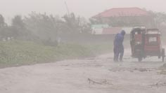 Man struggles in wind as typhoon Megi hits Aparri in the Philippines