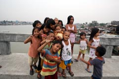 Street kids in Manila muck around prior to arrival of typhoon Mirinae