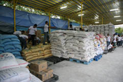 Soldier shift tons of aid waiting at a relief station in Manila